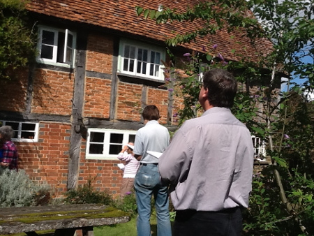 Members of the Wealden Buildings Study Group at a timber-framed house.